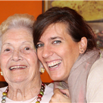Young woman laughing with grandmother.