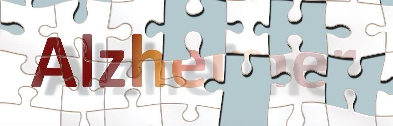 Puzzle with the word alzheimers on it and missing pieces