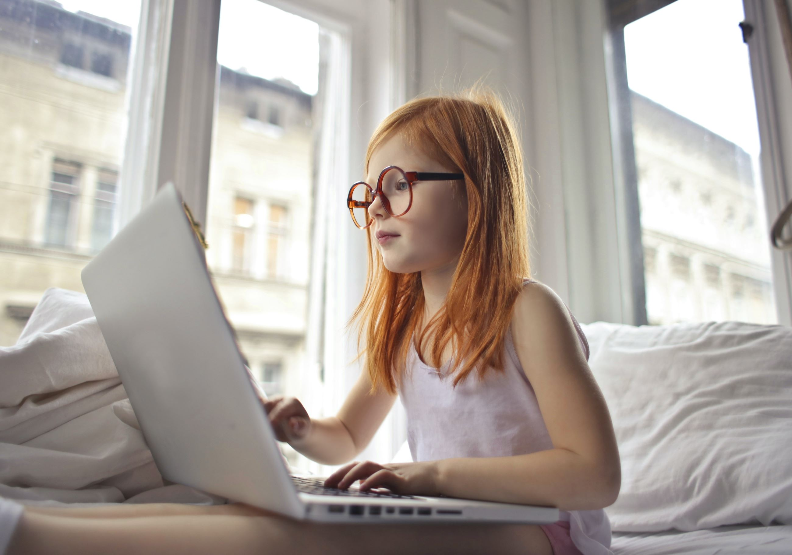 a-girl-watching-movie-on-computer-laptop-3761513 (1)